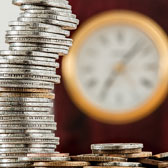 Money and Clock representing Mortgage and Financing